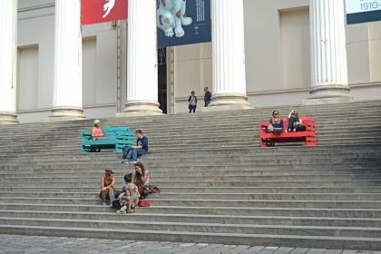 On the stairs of the museum