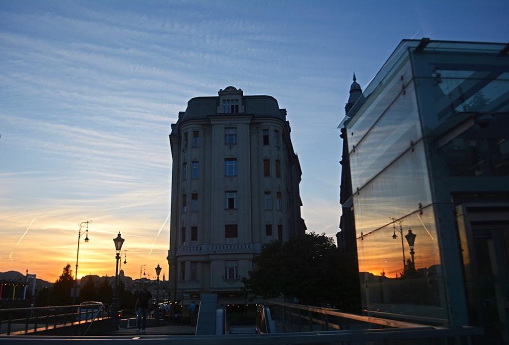 Sunset reflection on Fővám square