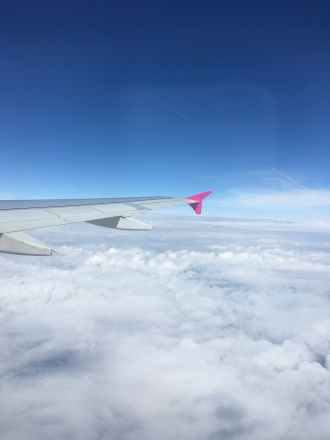 Compulsory wing of the plane over fluffy clouds shot